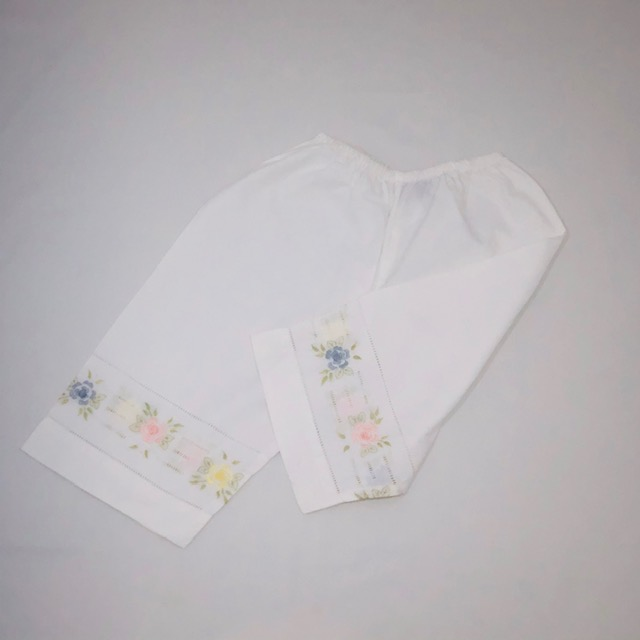 WHITE COTTON PANTS WITH EMBROIDERED COLOURED FLOWERS ON THE HEMLINE