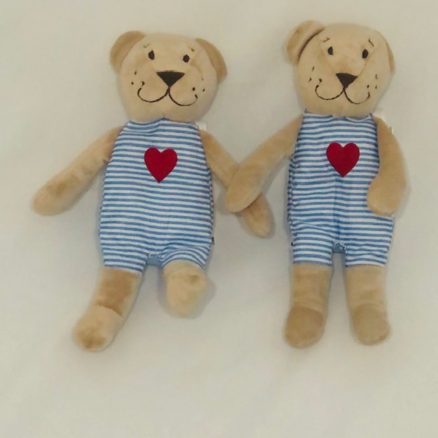 BEAR DRESSED IN STRIPED OUTFIT WITH RED HEART
