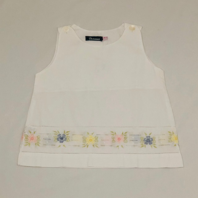 WHITE TOP WITH COLOURED EMBROIDERED FLOWERS ON THE HEM