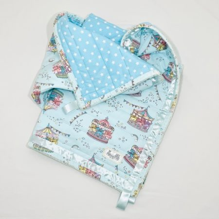 100% COTTON QUILTED CAROUSAL BABY BLANKET IN PASTELS